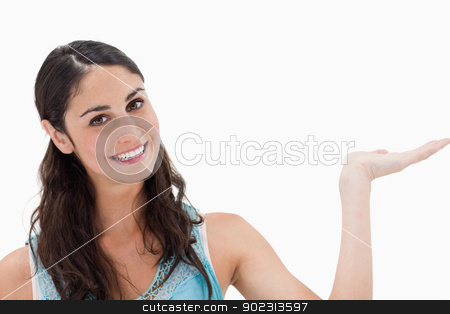 Smiling woman displaying a copy space stock photo, Smiling woman displaying a copy space against a white background by Wavebreak Media