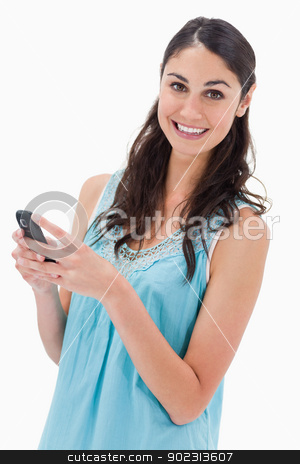 Portrait of a happy woman reading a text message stock photo, Portrait of a happy woman reading a text message against a white background by Wavebreak Media