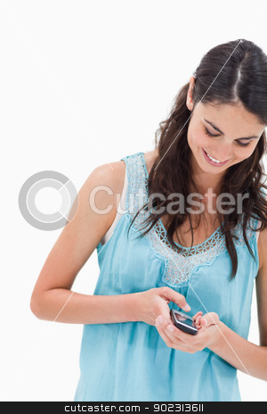 Portrait of a woman sending a text message stock photo, Portrait of a woman sending a text message against a white background by Wavebreak Media