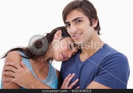Couple embracing each other stock photo, Couple embracing each other against a white background by Wavebreak Media