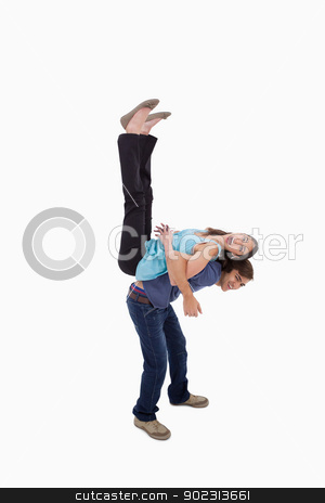 Portrait of a couple having fun together stock photo, Portrait of a couple having fun together against a white background by Wavebreak Media