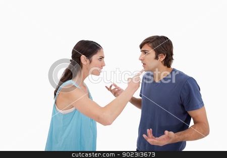 Young couple arguing stock photo, Young couple arguing against a white background by Wavebreak Media