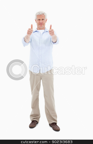 Man with the thumbs up stock photo, Man with the thumbs up against a white background by Wavebreak Media