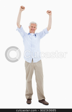 Portrait of a mature man with the arms up stock photo, Portrait of a mature man with the arms up against a white background by Wavebreak Media