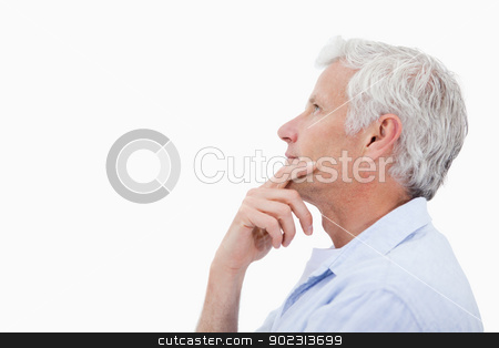 Side view of a man thinking stock photo, Side view of a man thinking against a white background by Wavebreak Media
