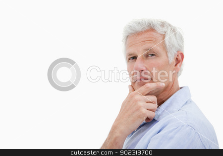 Mature man thinking stock photo, Mature man thinking against a white background by Wavebreak Media