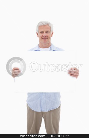 Portrait of a mature man holding a blank panel stock photo, Portrait of a mature man holding a blank panel against a white background by Wavebreak Media
