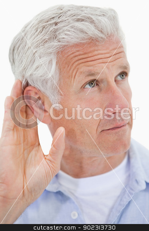 Portrait of a mature man giving his ear stock photo, Portrait of a mature man giving his ear against a white background by Wavebreak Media