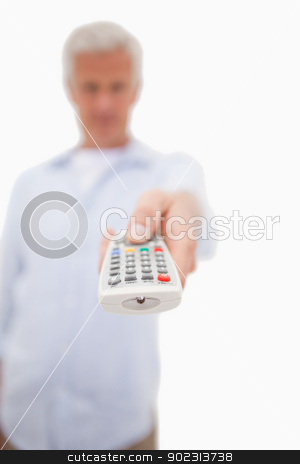 Portrait of a man switching of channel stock photo, Portrait of a man switching of channel against a white background by Wavebreak Media