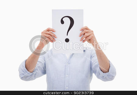 Portrait of a man hiding his face behind a question mark stock photo, Portrait of a man hiding his face behind a question mark against a white background by Wavebreak Media