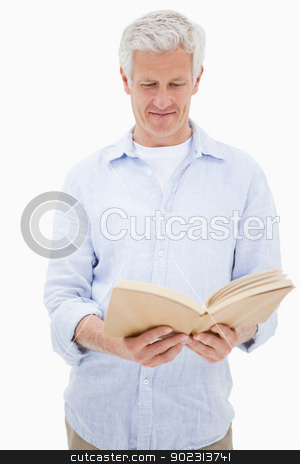 Portrait of a man reading a book stock photo, Portrait of a man reading a book against a white background by Wavebreak Media