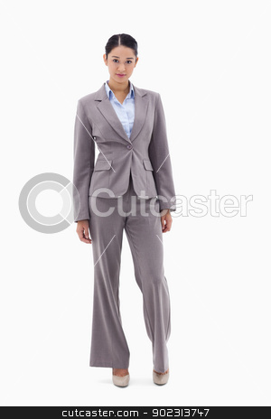 Portrait of a brunette businesswoman posing stock photo, Portrait of a brunette businesswoman posing against a white background by Wavebreak Media