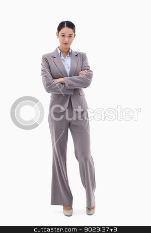 Portrait of a businesswoman posing with the arms crossed stock photo, Portrait of a businesswoman posing with the arms crossed against a white background by Wavebreak Media