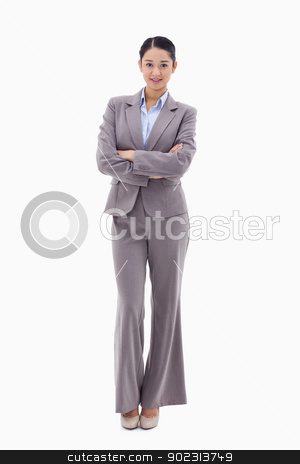 Portrait of a brunette businesswoman with the arms crossed stock photo, Portrait of a brunette businesswoman with the arms crossed against a white background by Wavebreak Media