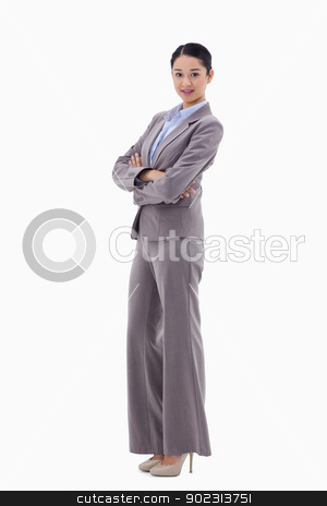 Portrait of a gorgeous businesswoman with the arms crossed stock photo, Portrait of a gorgeous businesswoman with the arms crossed against a white background by Wavebreak Media