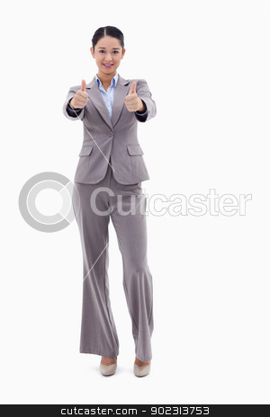 Portrait of a businesswoman posing with the thumbs up stock photo, Portrait of a businesswoman posing with the thumbs up against a white background by Wavebreak Media