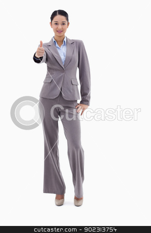 Portrait of a businesswoman posing with the thumb up stock photo, Portrait of a businesswoman posing with the thumb up against a white background by Wavebreak Media