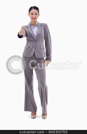 Portrait of a happy businesswoman posing with the thumb up stock photo, Portrait of a happy businesswoman posing with the thumb up against a white background by Wavebreak Media