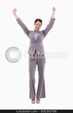 Portrait of a happy businesswoman posing with the arms up stock photo, Portrait of a happy businesswoman posing with the arms up against a white background by Wavebreak Media