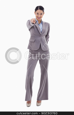 Portrait of a young brunette businesswoman pointing at the viewe stock photo, Portrait of a young brunette businesswoman pointing at the viewer against a white background by Wavebreak Media