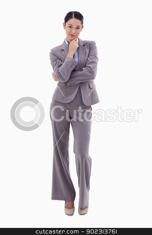 Portrait of a thoughtful brunette businesswoman stock photo, Portrait of a thoughtful brunette businesswoman against a white background by Wavebreak Media