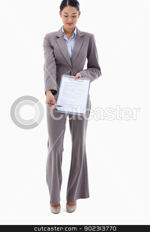 Portrait of a businesswoman showing a contract stock photo, Portrait of a businesswoman showing a contract against a white background by Wavebreak Media