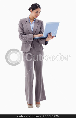 Portrait of a businesswoman using a laptop stock photo, Portrait of a businesswoman using a laptop against a white background by Wavebreak Media