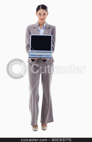 Portrait of a businesswoman showing a notebook stock photo, Portrait of a businesswoman showing a notebook against a white background by Wavebreak Media