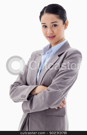 Portrait of a beautiful businesswoman posing with the arms cross stock photo, Portrait of a beautiful businesswoman posing with the arms crossed against a white background by Wavebreak Media