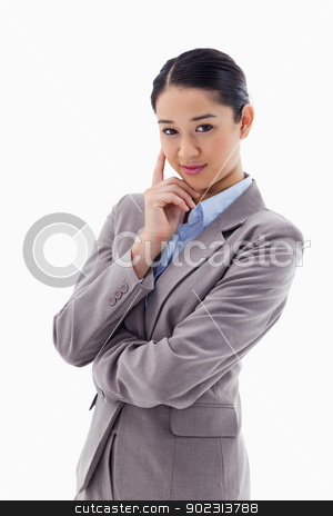 Portrait of a smiling businesswoman thinking stock photo, Portrait of a smiling businesswoman thinking against a white background by Wavebreak Media