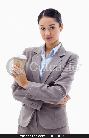 Portrait of a young businesswoman holding a takeaway tea stock photo, Portrait of a young businesswoman holding a takeaway tea against a white background by Wavebreak Media