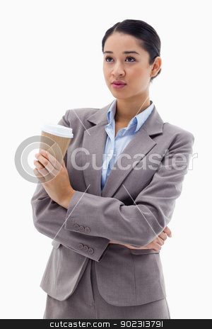 Portrait of a cute businesswoman holding a takeaway tea stock photo, Portrait of a cute businesswoman holding a takeaway tea against a white coffee by Wavebreak Media