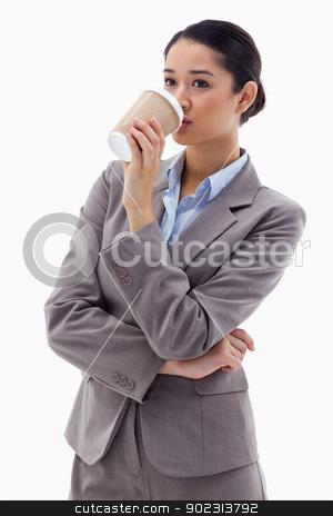 Portrait of a businesswoman drinking a takeaway tea stock photo, Portrait of a businesswoman drinking a takeaway tea against a white background by Wavebreak Media