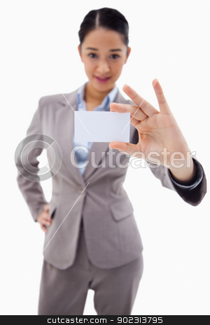 Portrait of a young businesswoman showing a blank business card stock photo, Portrait of a young businesswoman showing a blank business card against a white background by Wavebreak Media