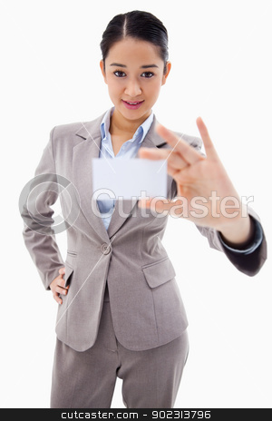 Portrait of a gorgeous businesswoman showing a blank business ca stock photo, Portrait of a gorgeous businesswoman showing a blank business card against a white background by Wavebreak Media