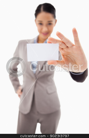 Portrait of a cute businesswoman showing a blank business card stock photo, Portrait of a cute businesswoman showing a blank business card against a white background by Wavebreak Media
