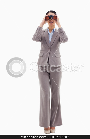 Portrait of a businesswoman looking through binoculars stock photo, Portrait of a businesswoman looking through binoculars against a white background by Wavebreak Media