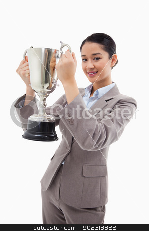 Portrait of a businesswoman holding a cup stock photo, Portrait of a businesswoman holding a cup against a white background by Wavebreak Media