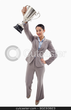 Portrait of a businesswoman showing a cup stock photo, Portrait of a businesswoman showing a cup against a white background by Wavebreak Media