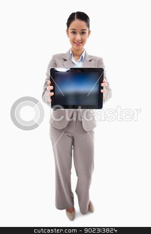 Portrait of a businesswoman showing a tablet computer stock photo, Portrait of a businesswoman showing a tablet computer against a white background by Wavebreak Media