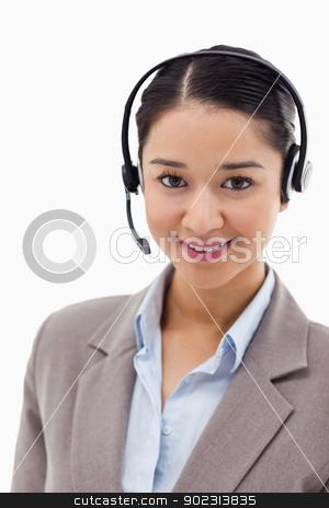 Portrait of an office worker posing with a headset stock photo, Portrait of an office worker posing with a headset against a white background by Wavebreak Media