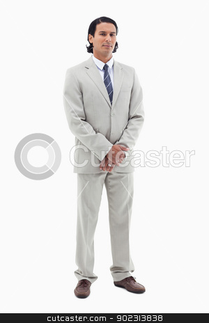 Portrait of an office worker standing up stock photo, Portrait of an office worker standing up against a white background by Wavebreak Media