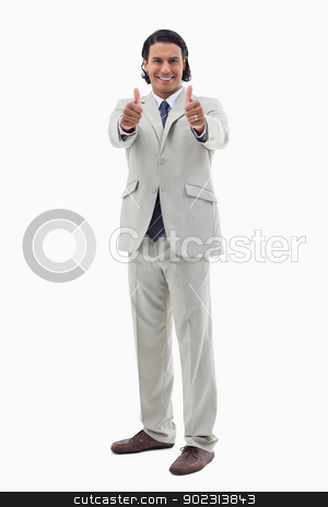 Portrait of an office worker posing with the thumbs up stock photo, Portrait of an office worker posing with the thumbs up against a white background by Wavebreak Media