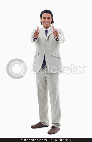 Portrait of a smiling office worker posing with the thumbs up stock photo, Portrait of a smiling office worker posing with the thumbs up against a white background by Wavebreak Media