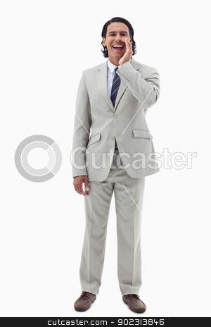 Portrait of an office worker shouting stock photo, Portrait of an office worker shouting against a white background by Wavebreak Media