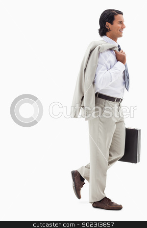 Portrait of a smiling businessman going to work stock photo, Portrait of a smiling businessman going to work against a white background by Wavebreak Media
