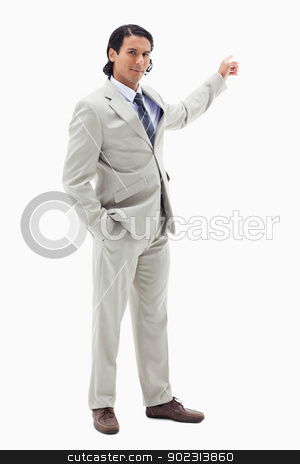 Portrait of a handsome businessman pointing at a copy space stock photo, Portrait of a handsome businessman pointing at a copy space against a white background by Wavebreak Media