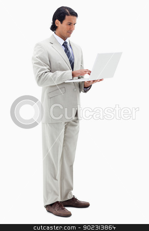 Portrait of a businessman using a notebook stock photo, Portrait of a businessman using a notebook against a white background by Wavebreak Media