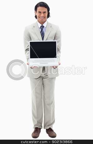 Portrait of a smiling businessman showing a notebook stock photo, Portrait of a smiling businessman showing a notebook against a white background by Wavebreak Media