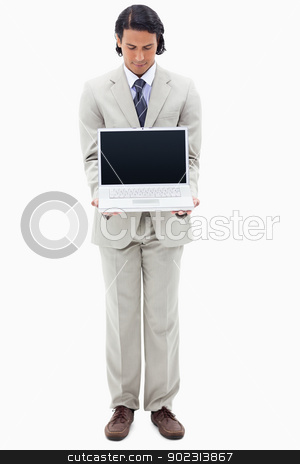 Portrait of a young businessman showing a notebook stock photo, Portrait of a young businessman showing a notebook against a white background by Wavebreak Media